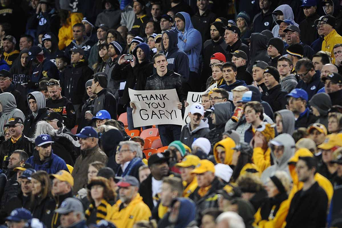 Fans hold signs and chant for Gary Pinkel throughout the game. Photo by Shane Epping.
