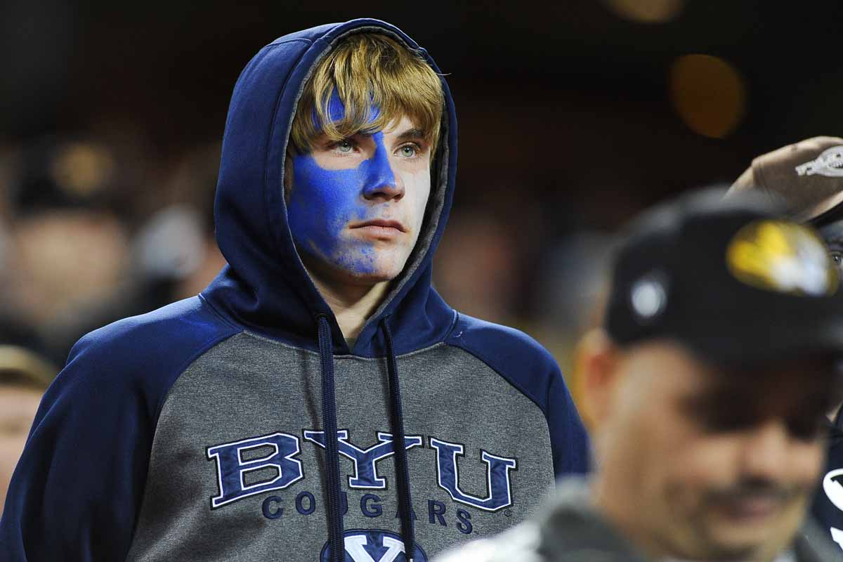 A dejected BYU fan faces the losing music near the end of the game. Photo by Shane Epping.