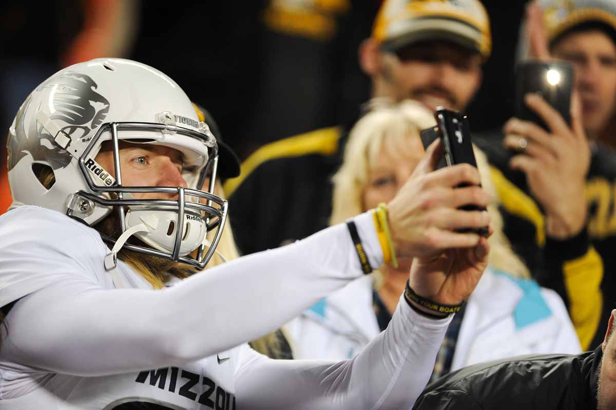 Junior punter Dayton Balvanz makes a quick selfie after the game. Photo by Shane Epping.