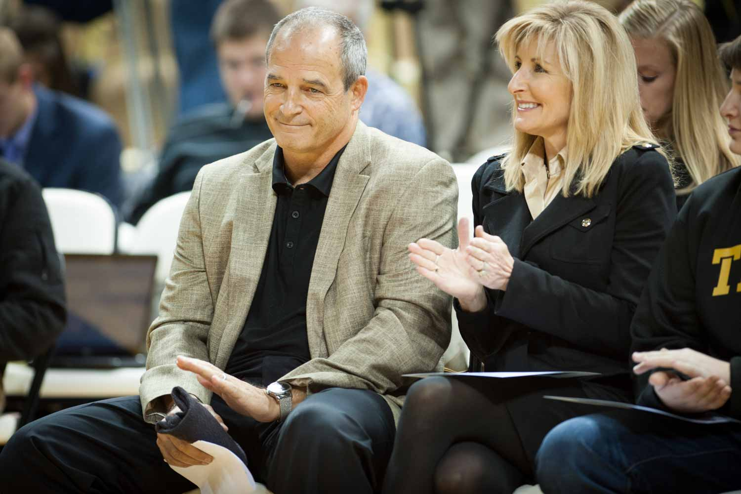 Coach Pinkel sits next to his wife, Missy Martinette, before delivering a speech to the audience at Mizzou Arena.