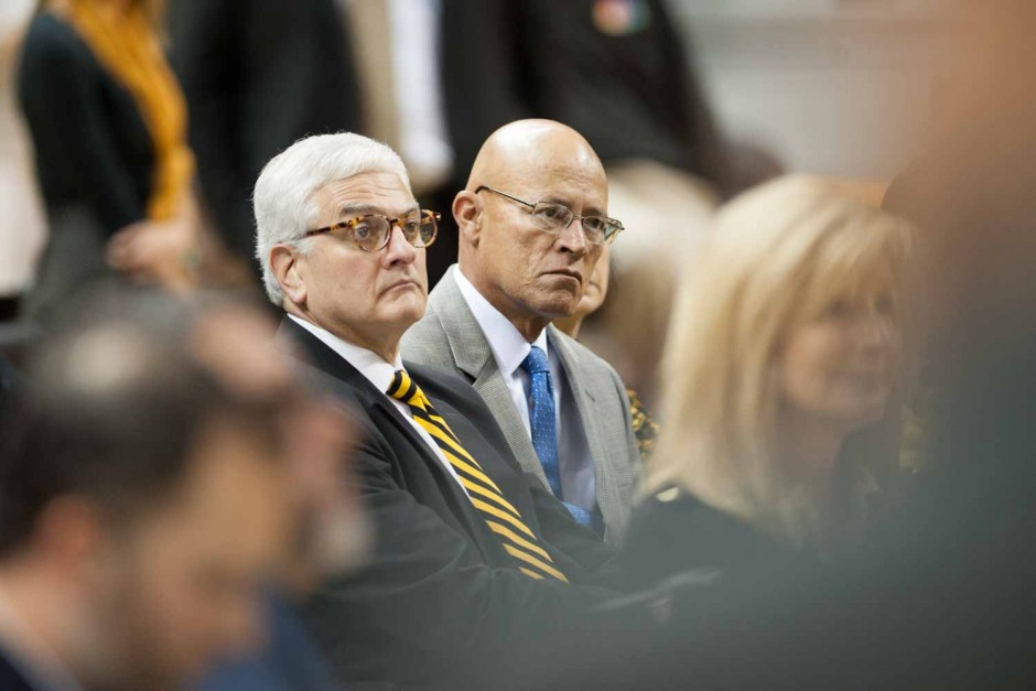 Interim chancellor Hank Foley and interim UM System President Mike Middleton sit in the crowd and listen to Coach Pinkel address questions from the press.