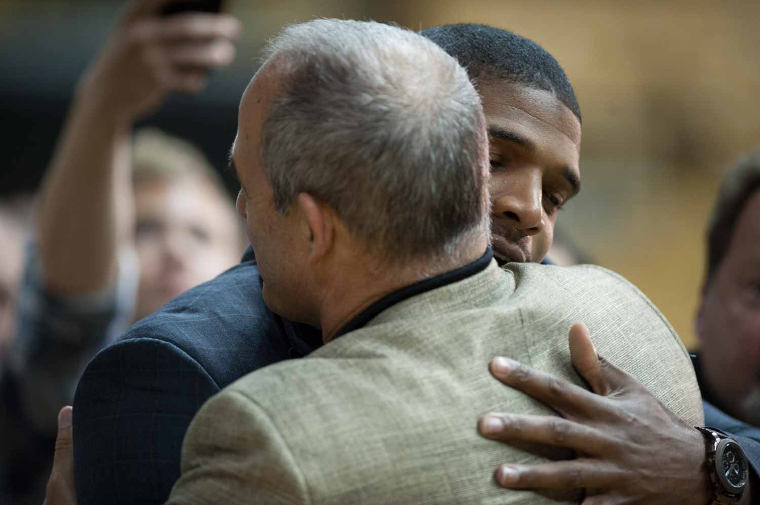 Michael Sam, 2013 SEC defensive player of the year, gives his former head football coach a hug after Pinkel finishes answering questions.