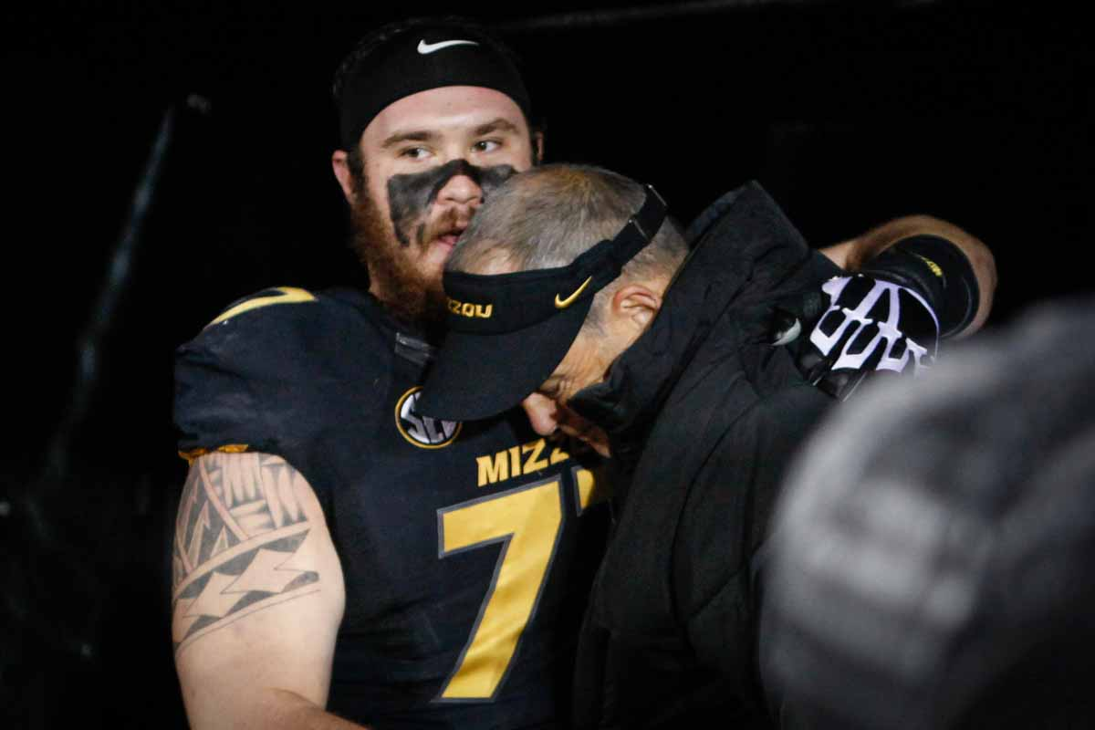 Evan Boehm (77), a senior team captain and center for the Tigers, hugs Head Coach Gary Pinkel before he takes the field prior to the game against Tennessee Saturday evening. Photo by Tanzi Propst.