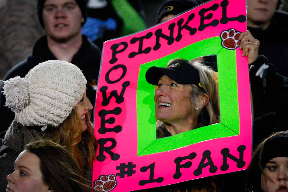 """Nathalie Hill, a junior, giggles at her mom, Carin Hill as she holds up her """"Pinkel Power, #1 Fan"""" sign, hoping to get on the video board during the game against Tennessee Saturday evening. Carin wishes Head Coach Gary Pinkel well in his health, commending him for giving the Tigers a wonderful 15 years. Photo by Tanzi Propst."""