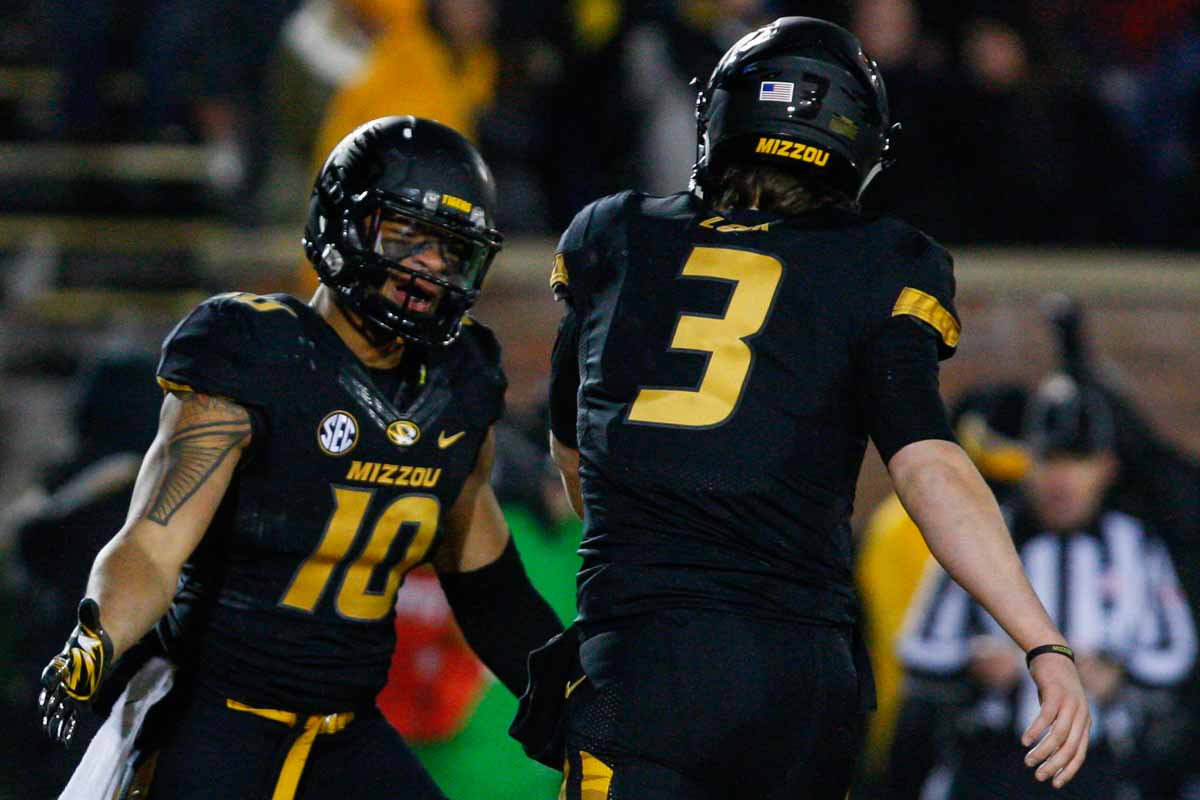 Jason Reese (10), a tight end for the Tigers, celebrates a touchdown with quarterback Drew Lock (3) near the end of the first half of the game against Tennessee Saturday evening at Faurot Field. Photo by Tanzi Propst.