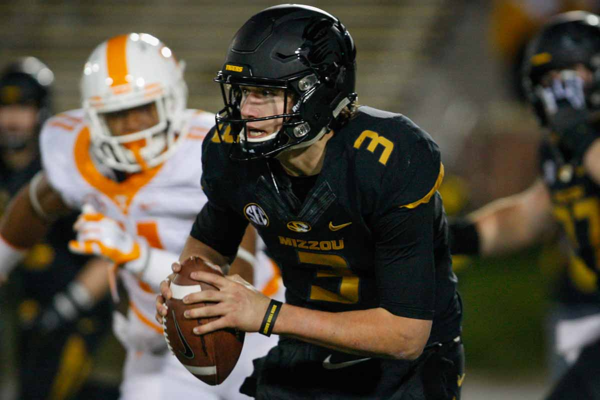 Freshman quarterback Drew Lock (3) runs the ball after the snap during the beginning of the second half of the game against the Tennessee Volunteers Satruday evening. Photo by Tanzi Propst.