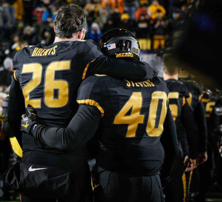 Jake Brents (26), a wide receiver for the Tigers, puts his arm around Andrew Stevens (40), a tailback, as they watch Head Coach Gary Pinkel walk off the field and into the locker room following the 8-19 loss against the Tennessee Volunteers Saturday evening. Photo by Tanzi Propst.
