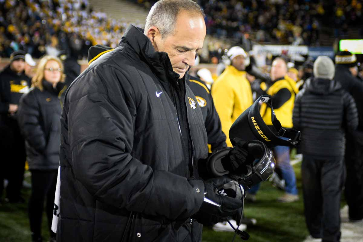 Coach Pinkel prepares to put on his signature Mizzou visor one last time at Memorial Stadium. Photo by Shane Epping.