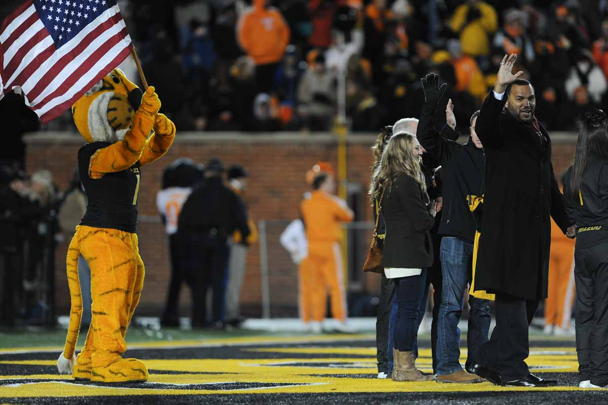 Truman waves Ol' Glory when a US veteran is honored on the field during a timeout. Photo by Shane Epping.