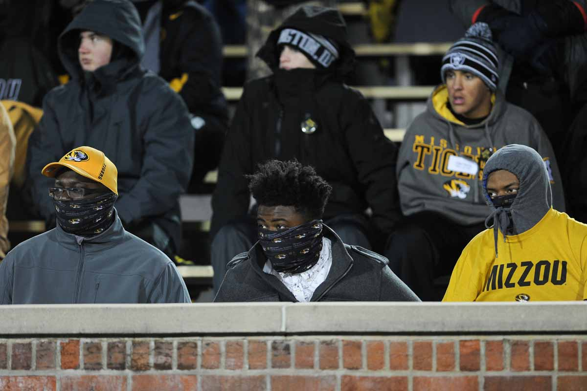John Graves, left, John Graves, Jr, and Terrian Ray bundle up in the frigid conditions. Photo by Shane Epping.