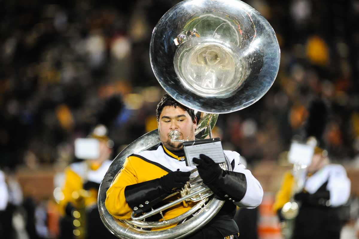 A member of Marching Mizzou keeps his eyes on the music while playing the sousaphone during halftime. Photo by Shane Epping.