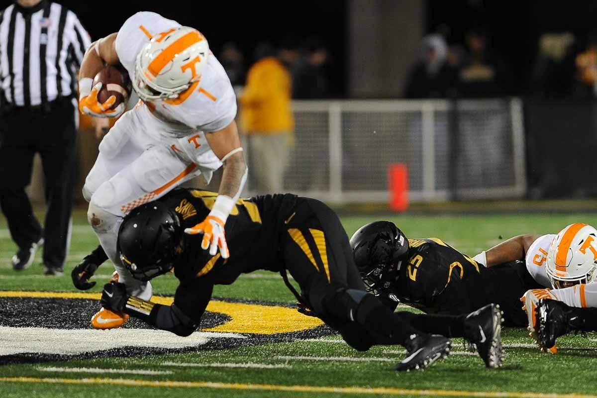 Sophomore defensive lineman Charles Harris brings down Tennessee's running back Jalen Hurd. Photo by Shane Epping.