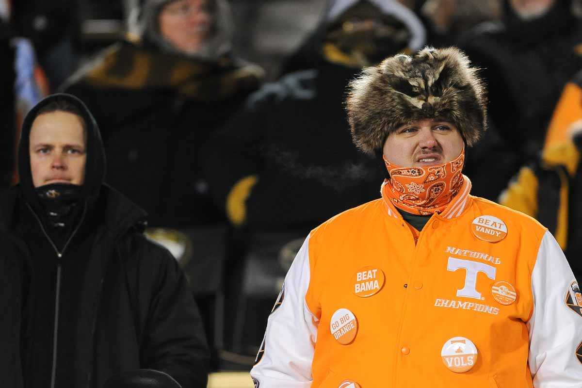 A racoon finds a warm place to rest on the head of a Tennessee Vols fan. Photo by Shane Epping.