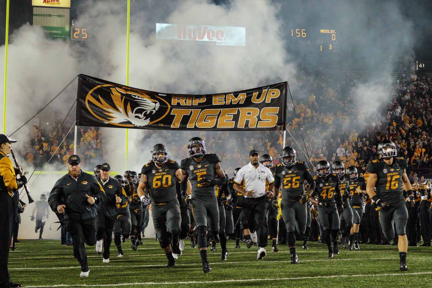 The Mizzou Tigers rush onto the field with thousands of fans cheering. Photo by Allison Collins.