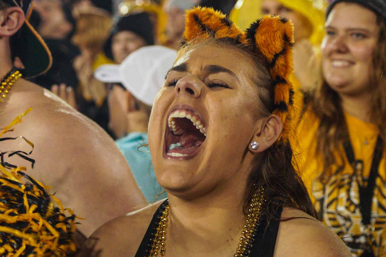 Gretchen Shackelford screams after a successful play by Mizzou's offensive line. Photo by Allison Collins.