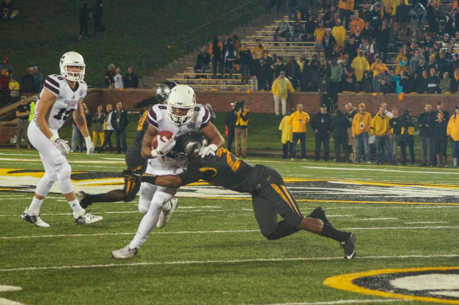 Mizzou DB, Anthony Sherrils tackles Mississippi WR, Fred Ross. Photo by Allison Collins.