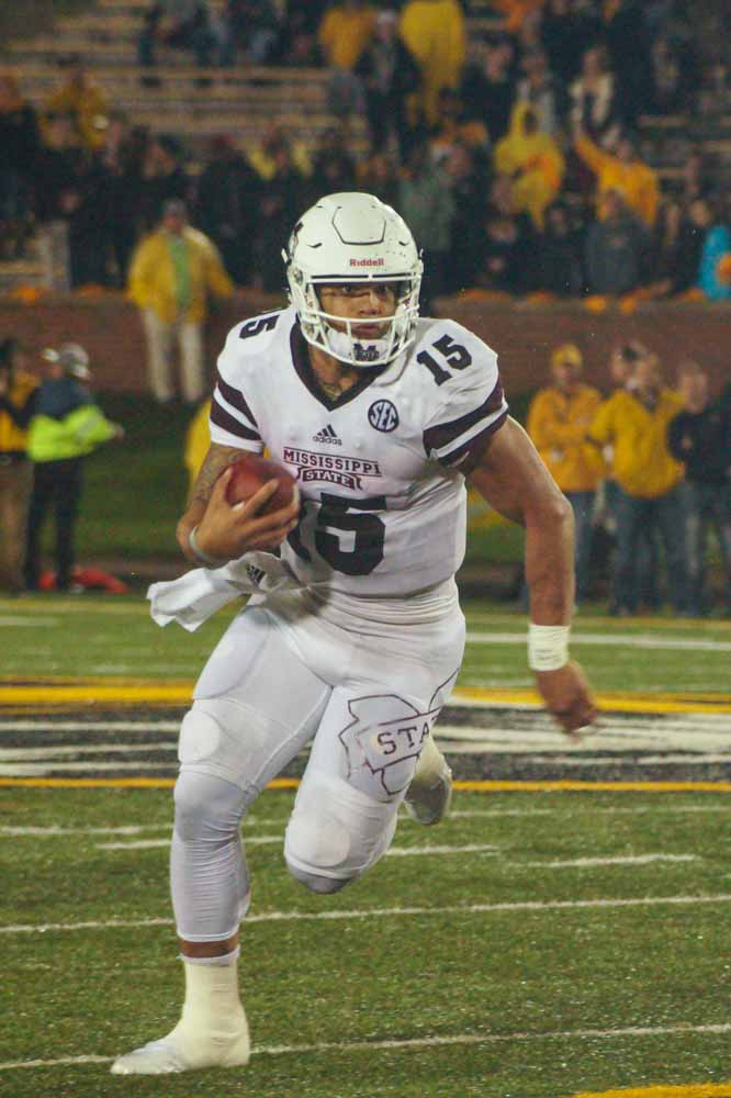 Mississippi State QB, Dak Prescott attempts to make a run on the play. Photo by Allison Collins.