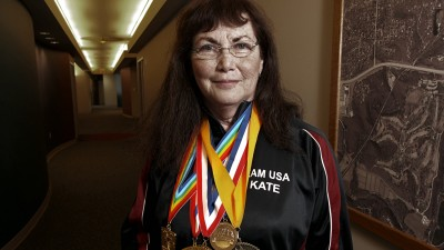 Kate Walker wearing medals.