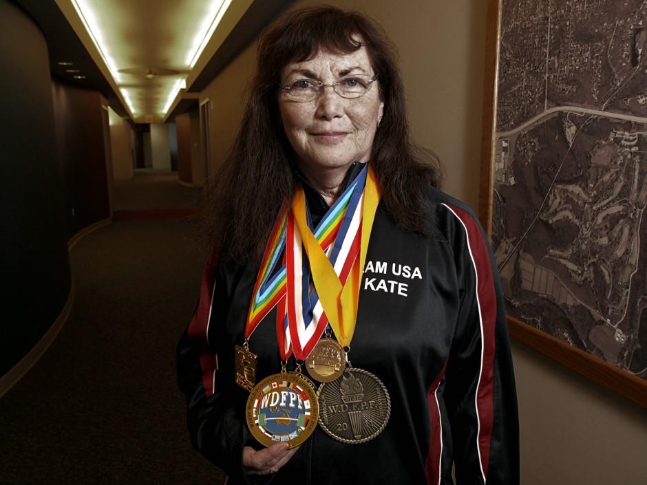 Kate Walker wearing medals.