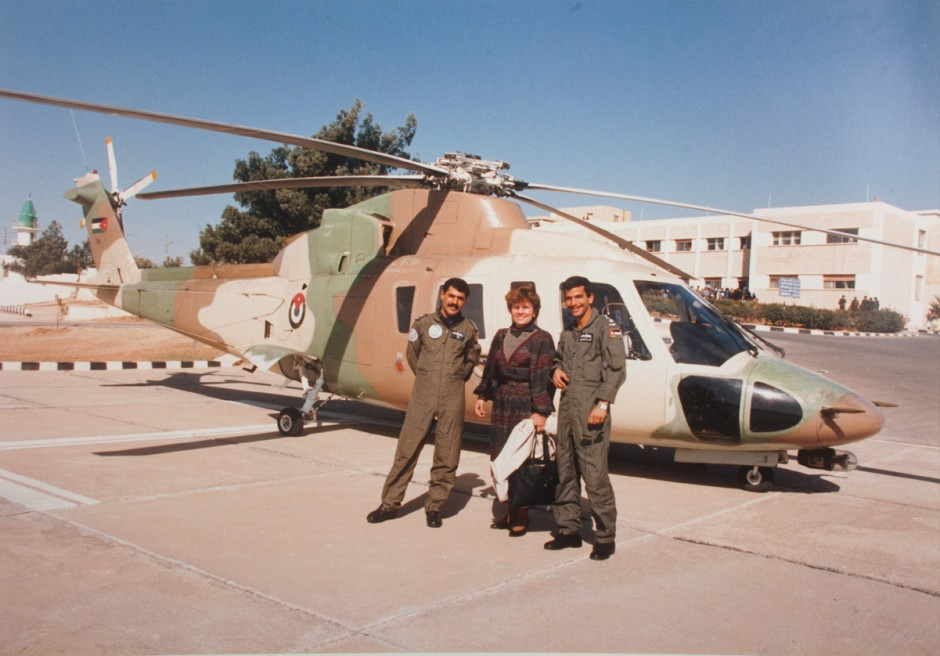 Winnie Fritz and fellow officers in front of a helicopter.