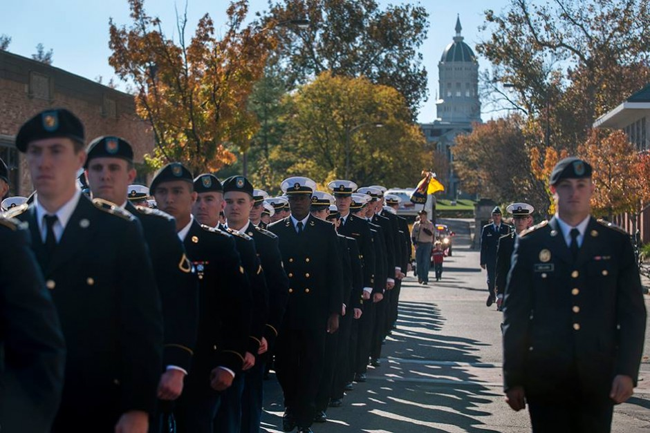 ROTC students parading down 8th street