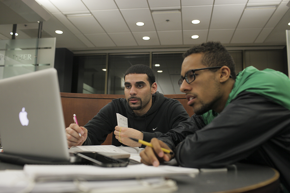 Two students studying with laptops.
