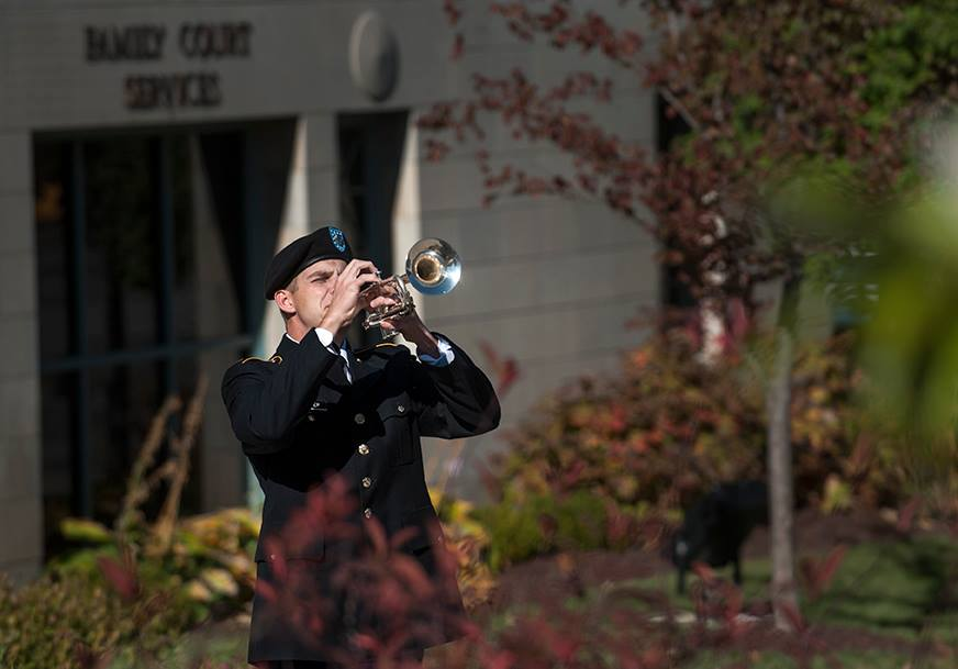 ROTC student playing taps.