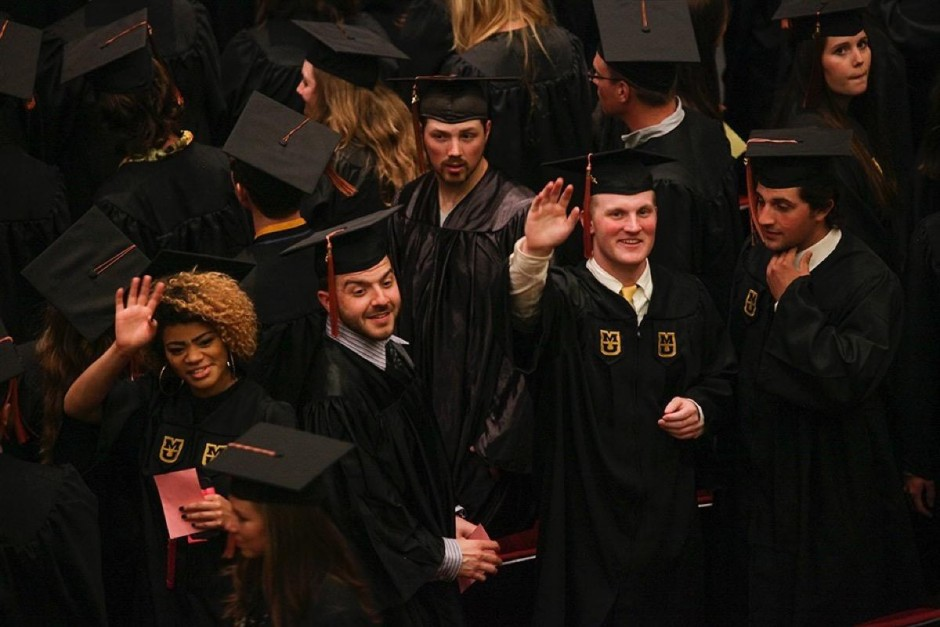 Group of students in caps and gowns.