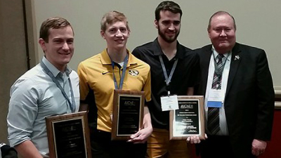 Students posing with awards.