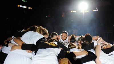 Women's basketball team in huddle