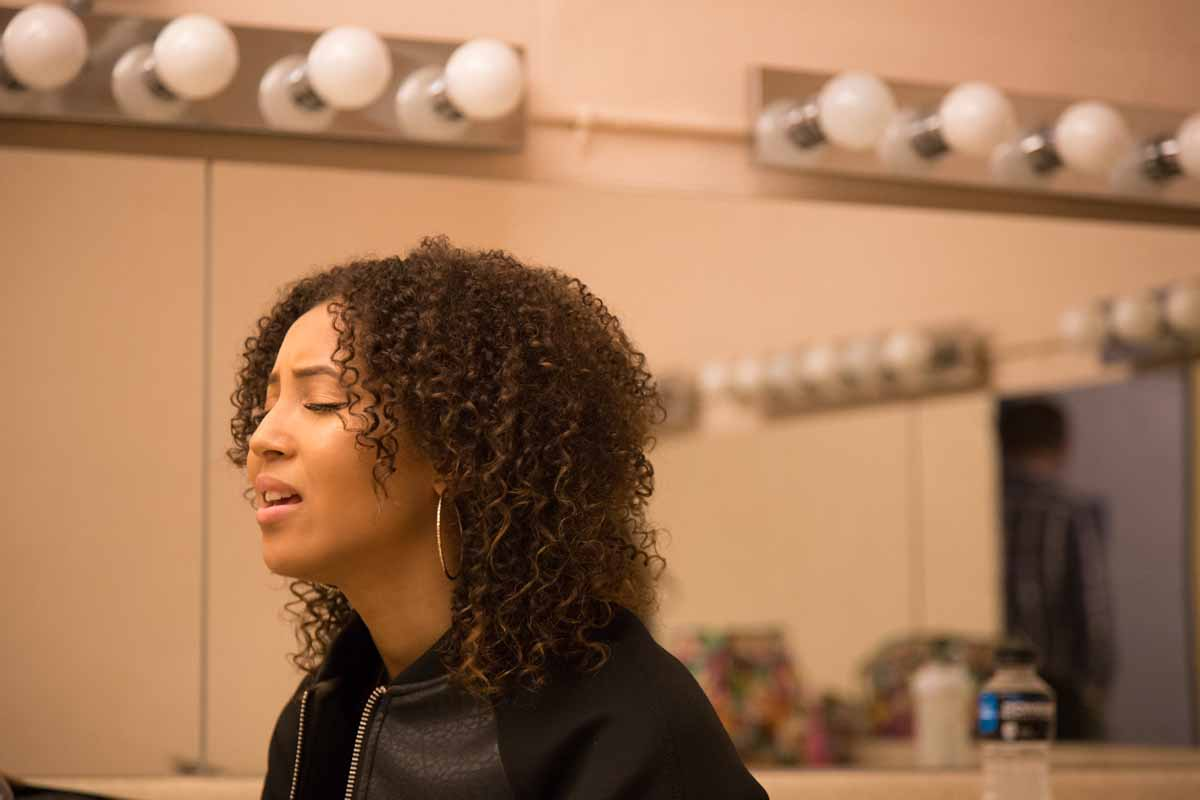 Mizzou Idol contestant Jhaere Mitchell practices her lines in the dressing room before taking the stage. Photo by Jake Hamilton.