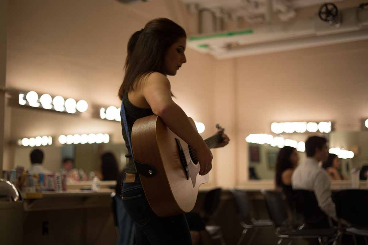 After moving on to the final round, Mizzou Idol contestant Breanna Lehane practices her second song of the night in the dressing room. Photo by Jake Hamilton.