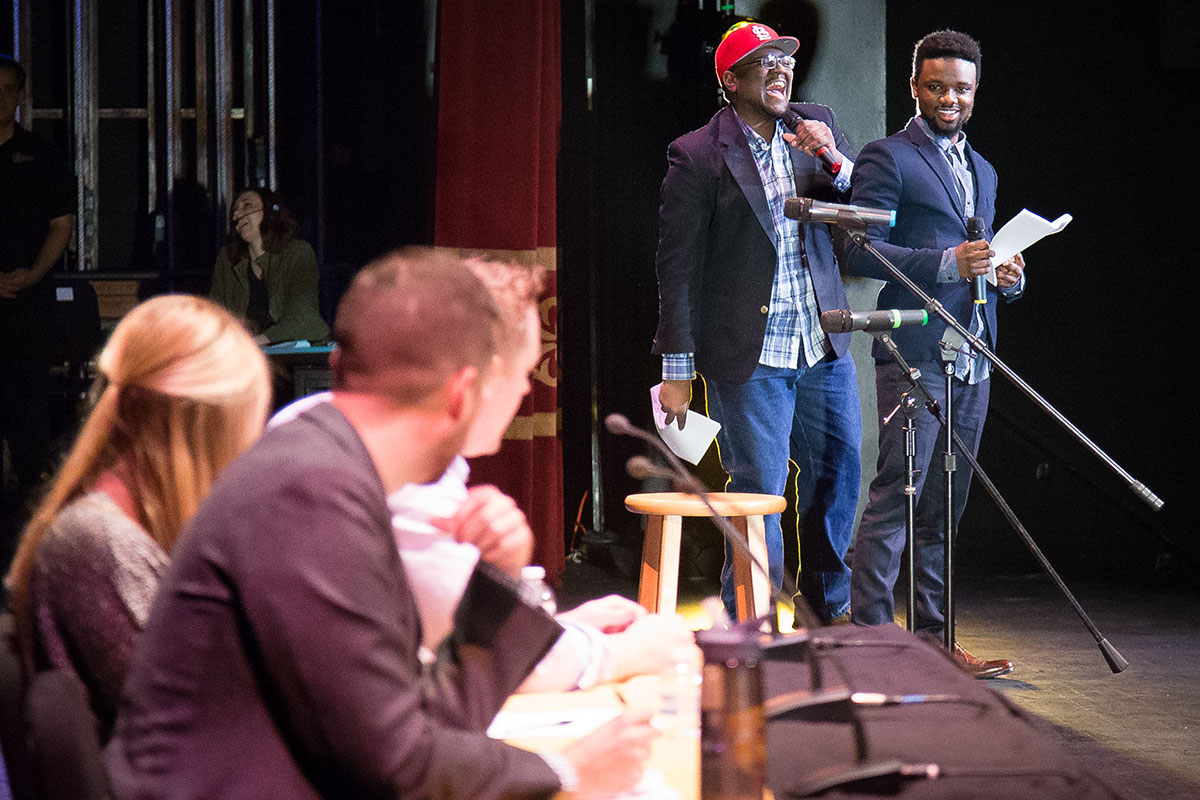 Emcees and judges joke onstage waiting for the next round of announcements for the show. Photo by Jake Hamilton.