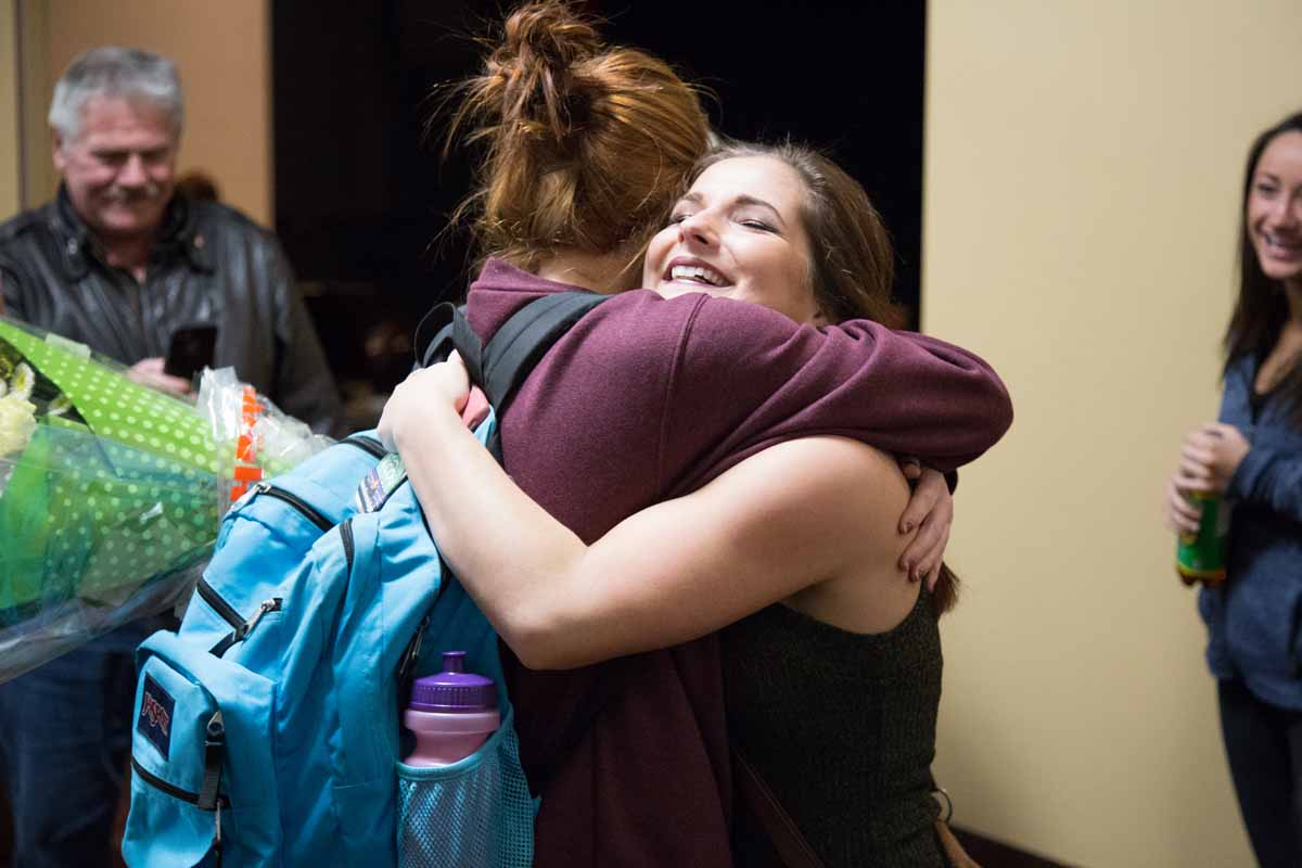Mizzou Idol winner Breanna Lehane embraces friends and family after the conclusion of Mizzou Idol 2016. Photo by Jake Hamilton.