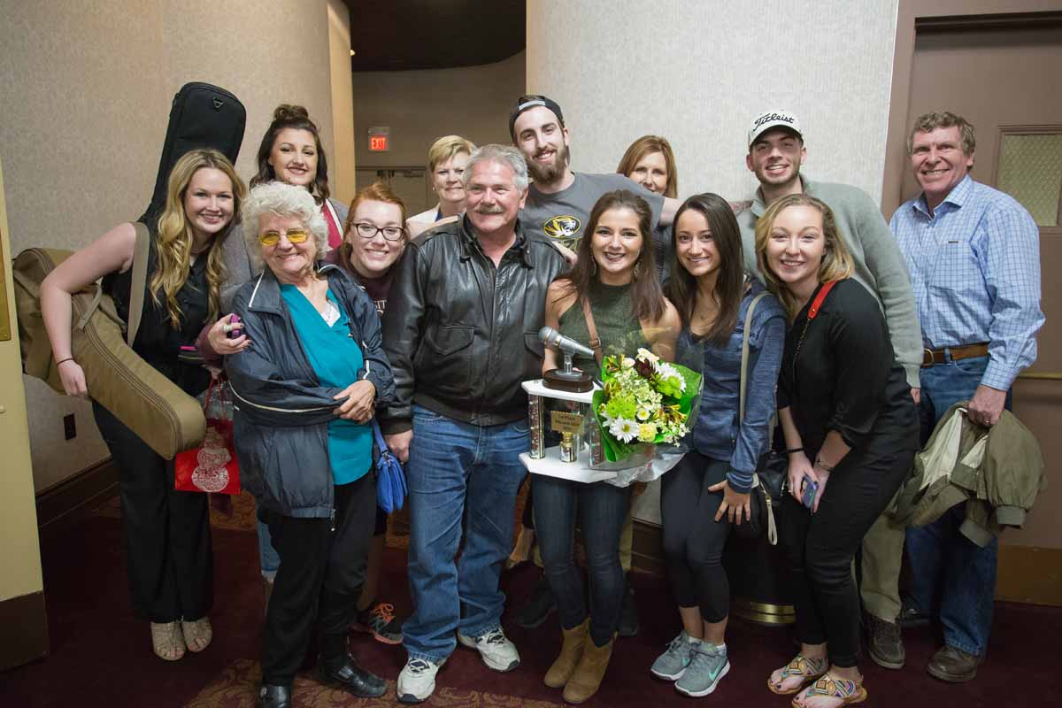 Mizzou Idol Winner Breanna Lehane poses with friends and family along with her first place trophy after the show. Photo by Jake Hamilton.