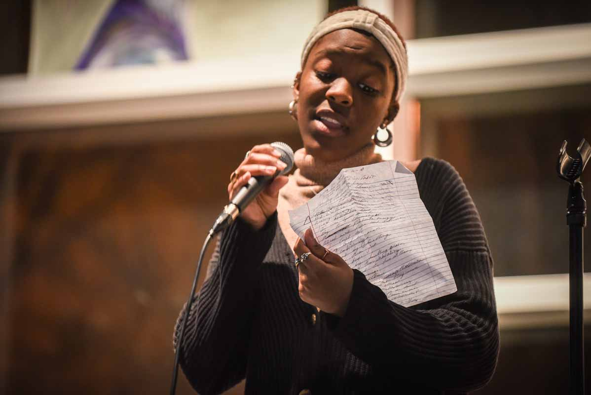 Amuche Nwafor was the first performance of the night and recited a poem for a crowd of a few hundred students. Photo by Morgan Lieberman.