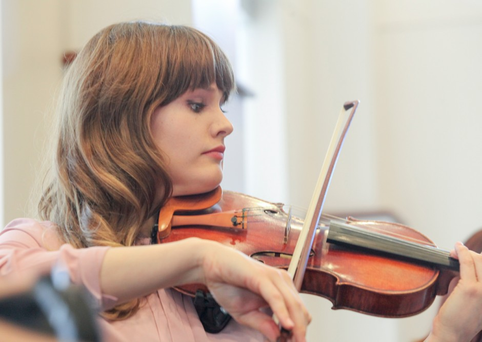 Young woman playing a violin.