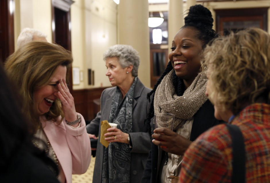 "From left, Zora Mulligan and Tamar Hodges laugh with Kelley Stuck during the reception in the foyer of Jesse Hall just before the ""Contesting Slavery: Enslaved MissouriansÕ Enduring Struggle for Self Determination"" presentation Wednesday evening, Feb. 3, 2016."