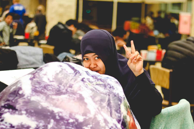 Dewi Endah Kharismawati, member of the Missouri International Student Council, aerates an Earth inflatable. Photo by Hanna Yowell.
