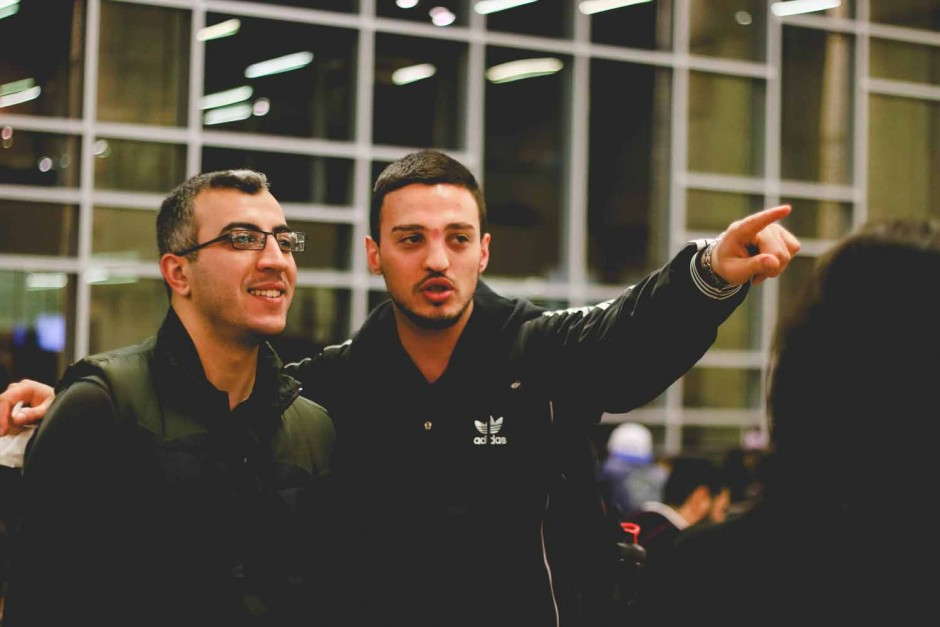 Anes Ouadou and Fis Malësori converse during the International Welcome Party. Ouadou is a Fulbright scholar from Algeria and Malësori is an MBA student from Kosovo. Photo by Hanna Yowell.