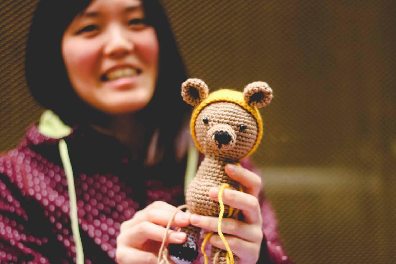 Nana Kizaki displays a handmade lion which she is in the process of crocheting. Photo by Hanna Yowell.