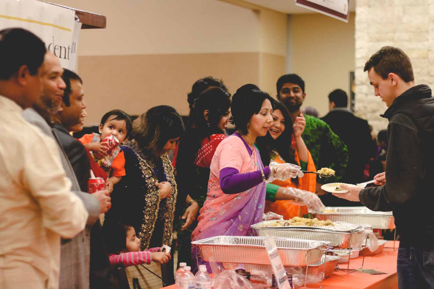 The Bangladesh Student Association shares traditional dishes with fellow MU students. Photo by Hanna Yowell.