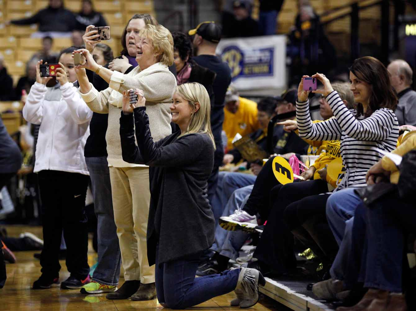 Parents record their daughters on their cell phones during a pre-game show with the Golden Girls Thursday evening, Feb. 11, 2016 at Mizzou Arena.