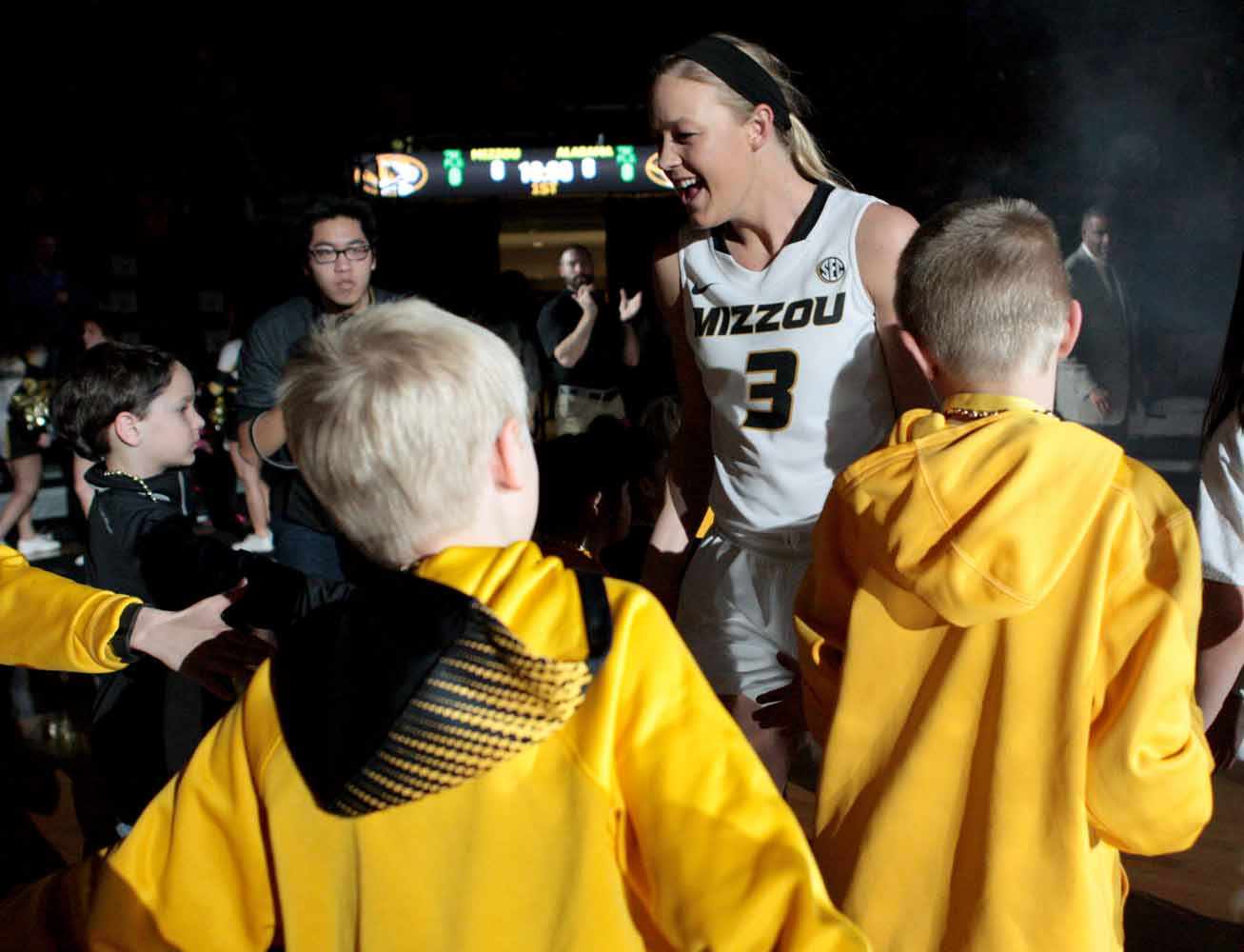 Sophie Cunningham (3) runs onto the court, greeting fans, after being called in Mizzou's starting lineup against Alabama Thursday evening, Feb. 11, 2016.