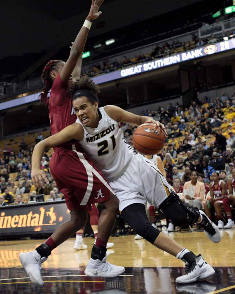Mizzou's Cierra Porter (21) pushes past an Alabama player in hopes of scoring a couple points for the Tigers during the second quarter of the game Thursday evening, Feb. 11, 2016.