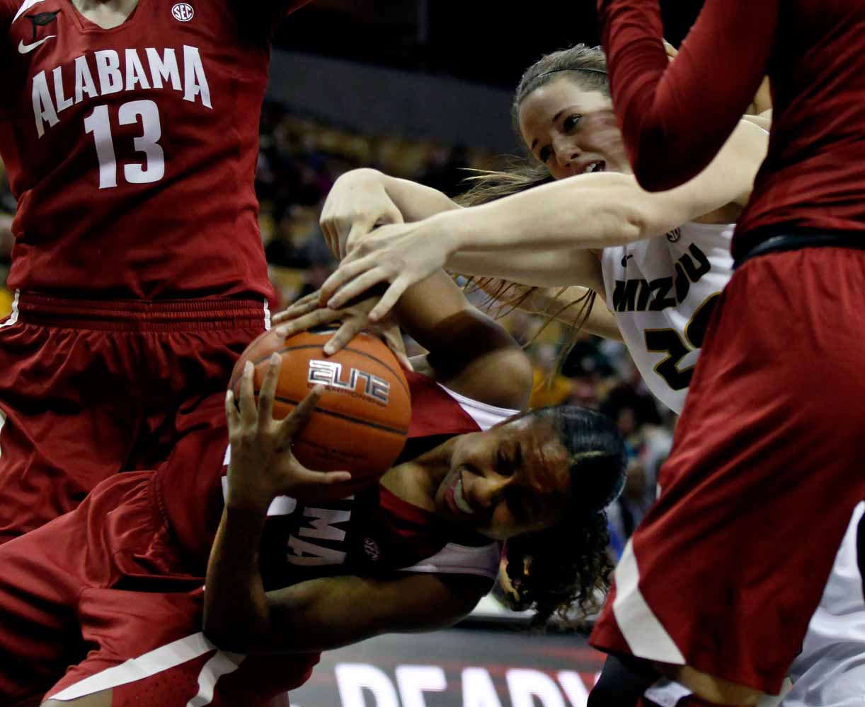 Alabama's sophomore guard Karyla Middlebrook (22) tries to steal the ball away from Missouri's redshirt sophomore forward Kayla McDowell (20) during the second half of the game Thursday evening, Feb. 11, 2016 at Mizzou Arena.