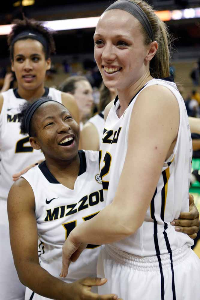 Carrie Shephard (15) hugs Michelle Hudyn (12) as they head off the court and into the locker room following the Tigers' 63-52 win over Alabama Thursday evening, Feb. 11, 2016.
