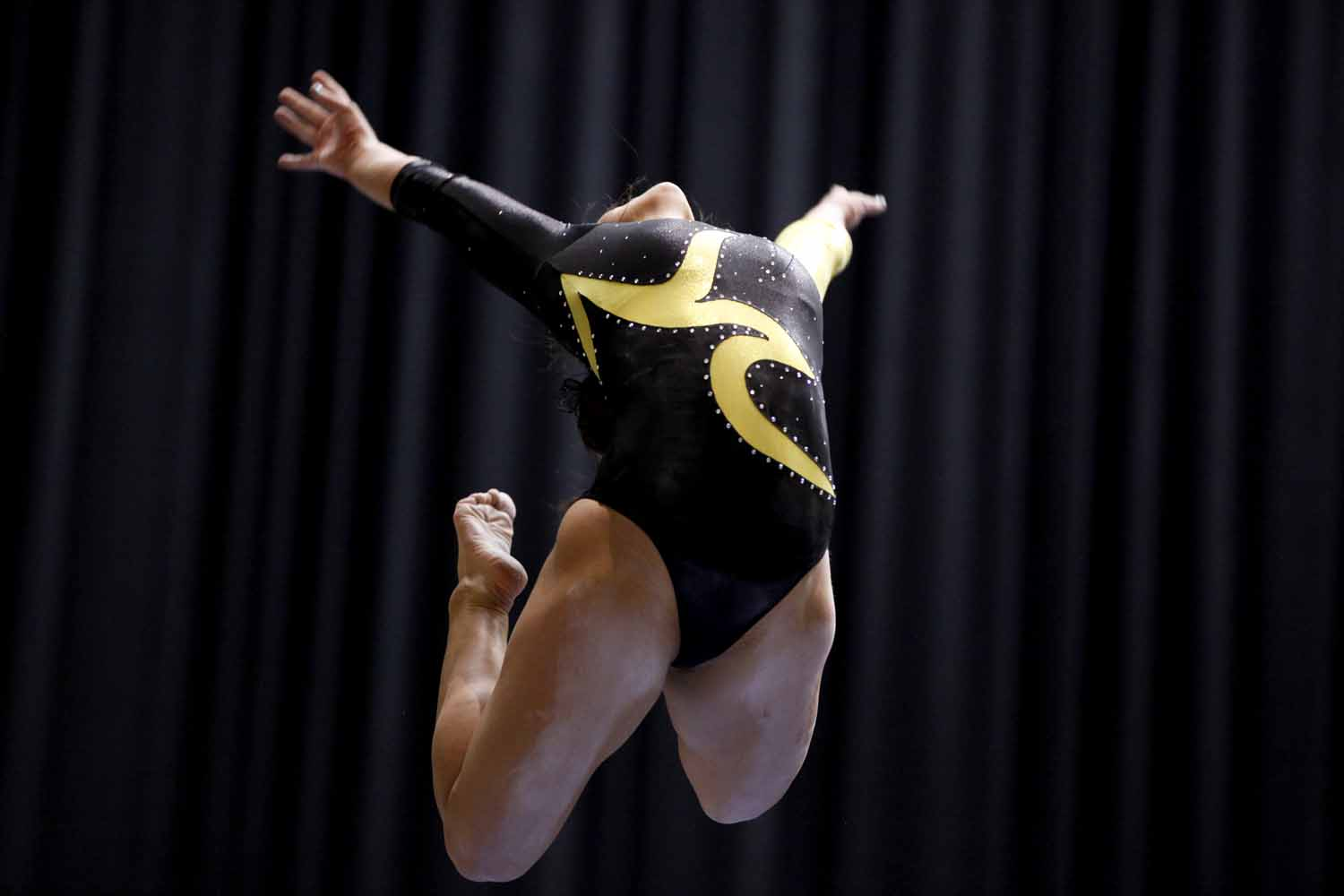 Mizzou freshman Brooke Kelly jumps into a pose during her performance on the balance beam Friday evening, Feb. 19, 2016 at the Hearnes Center.