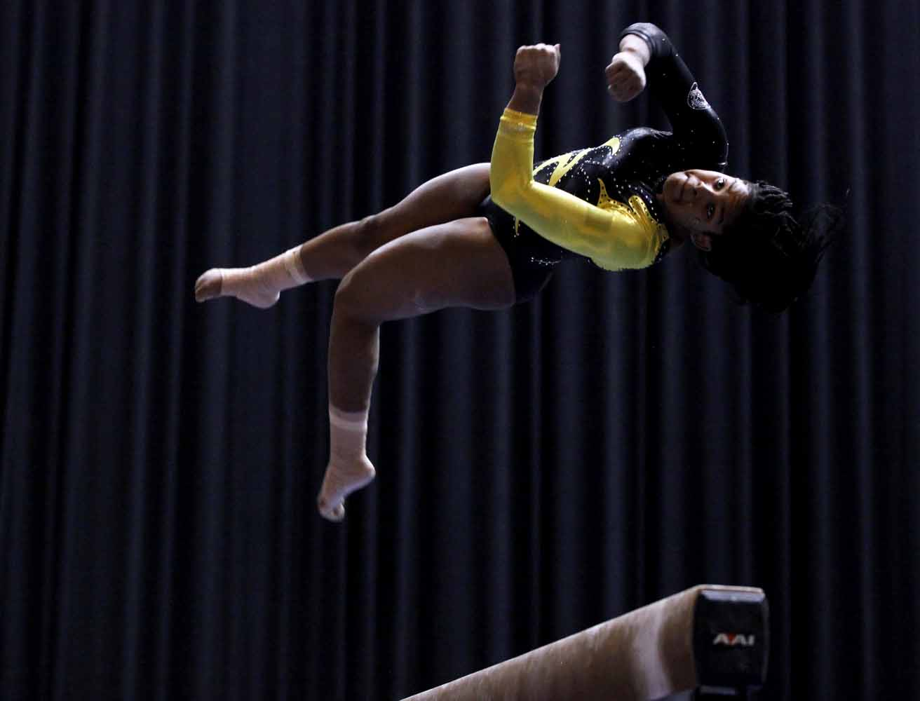 Mizzou sophomore Tia Allbritten jumps and twists during her performance on the balance beam Friday evening, Feb. 19, 2016 during the gymnastics competition against the University of Florida.