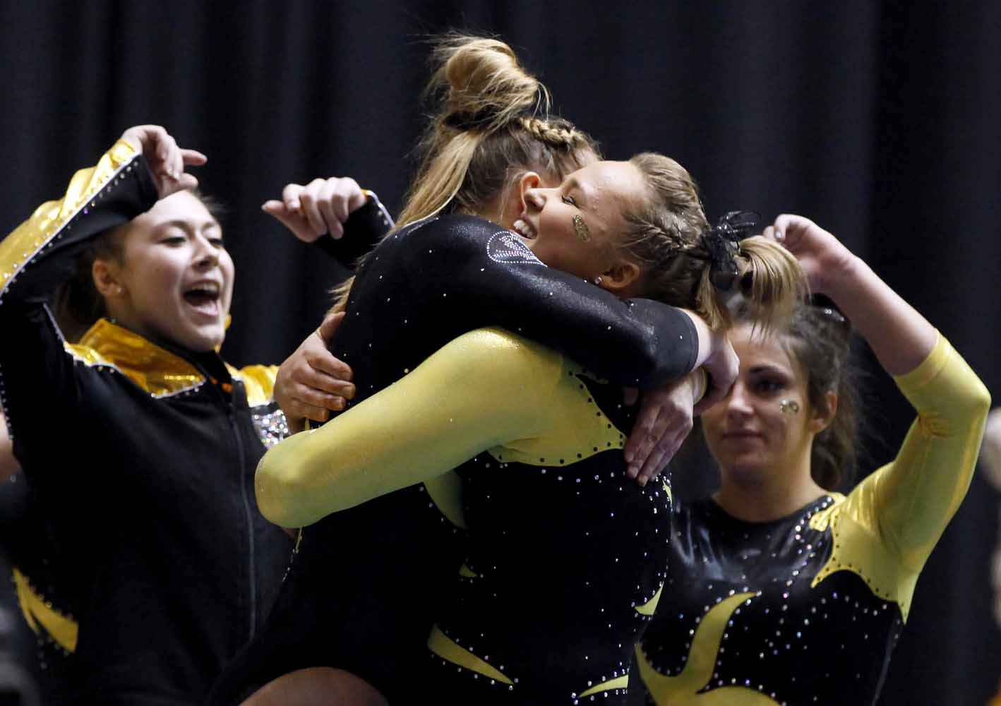 Mizzou freshman Britney Ward hugs freshman teammate Morgan Porter after sticking the landing to her balance beam performance Friday evening, Feb. 19, 2016 at the Hearnes Center.